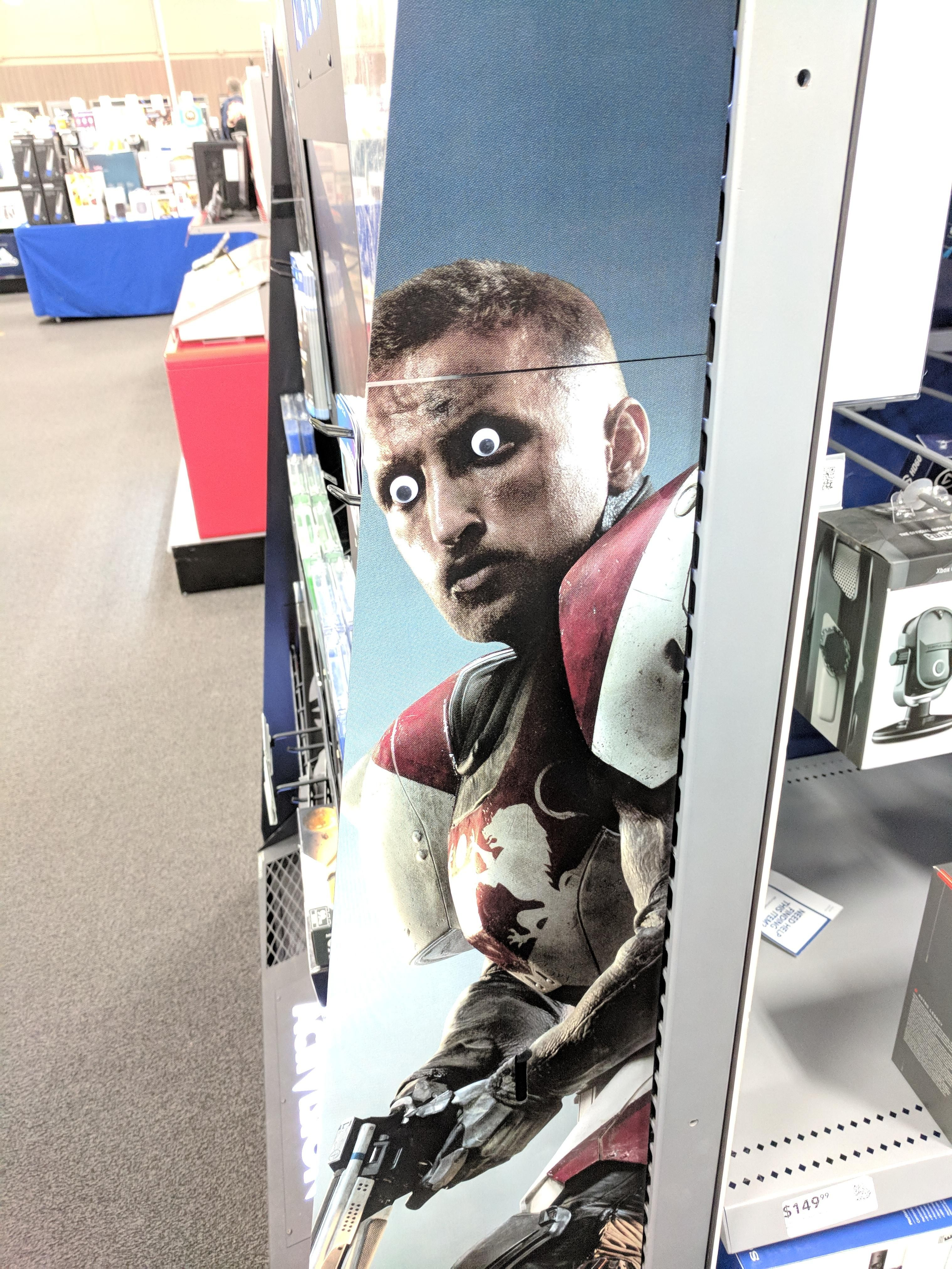 Someone placed googly eyes on this Destiny 2 display at Best Buy.