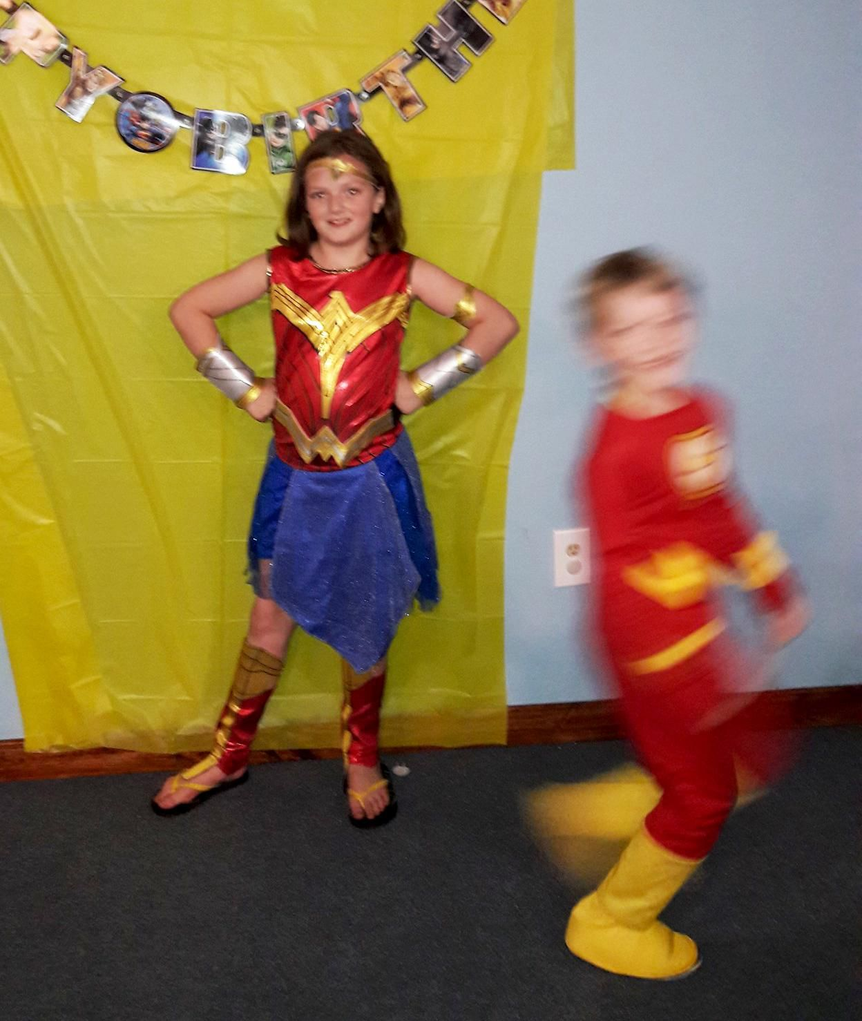 My son, as the Flash, decided to photobomb his sister