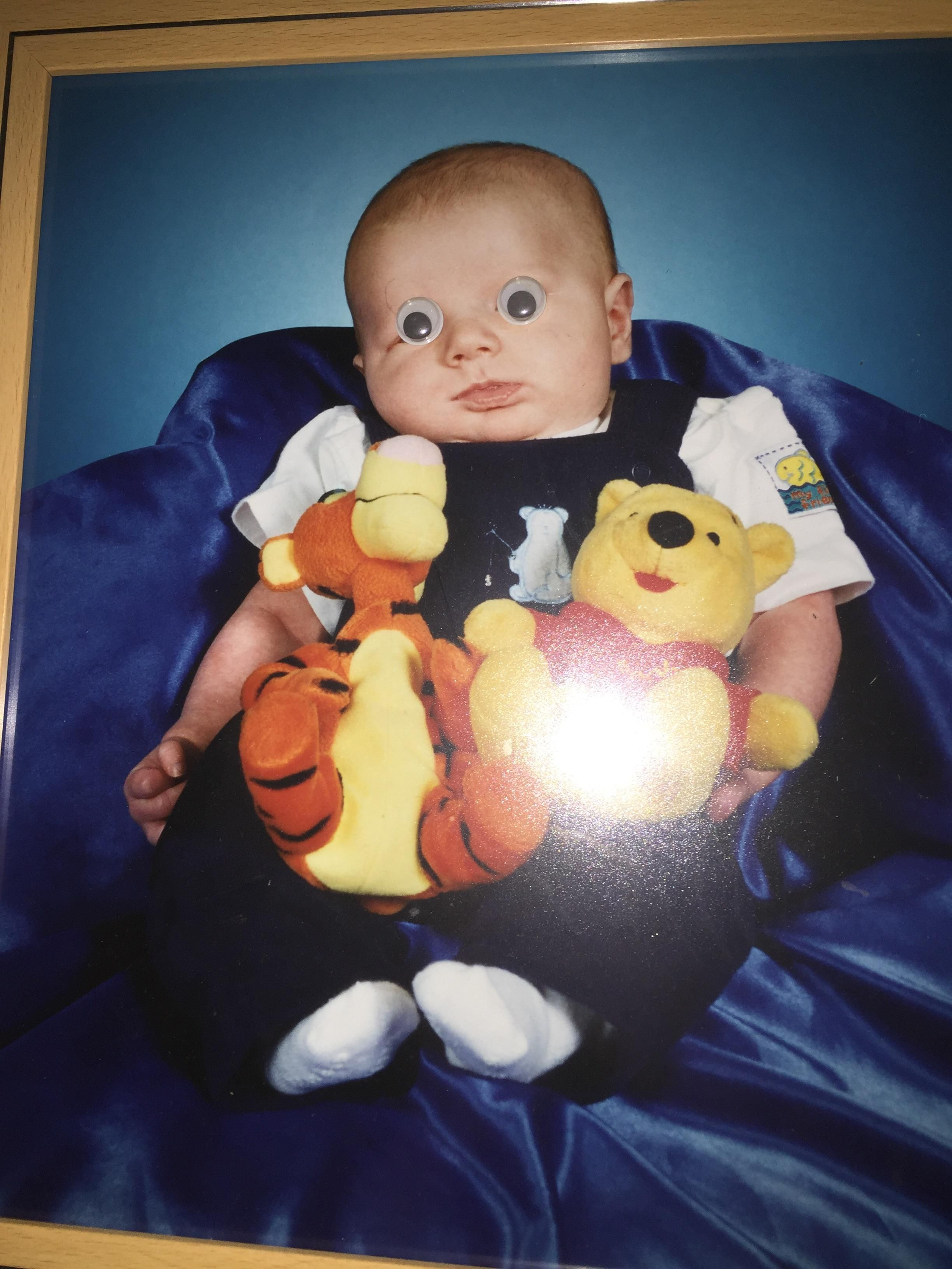 About 5 years ago, I put googly eyes on a picture of my brother as a baby. They're still there to this day.