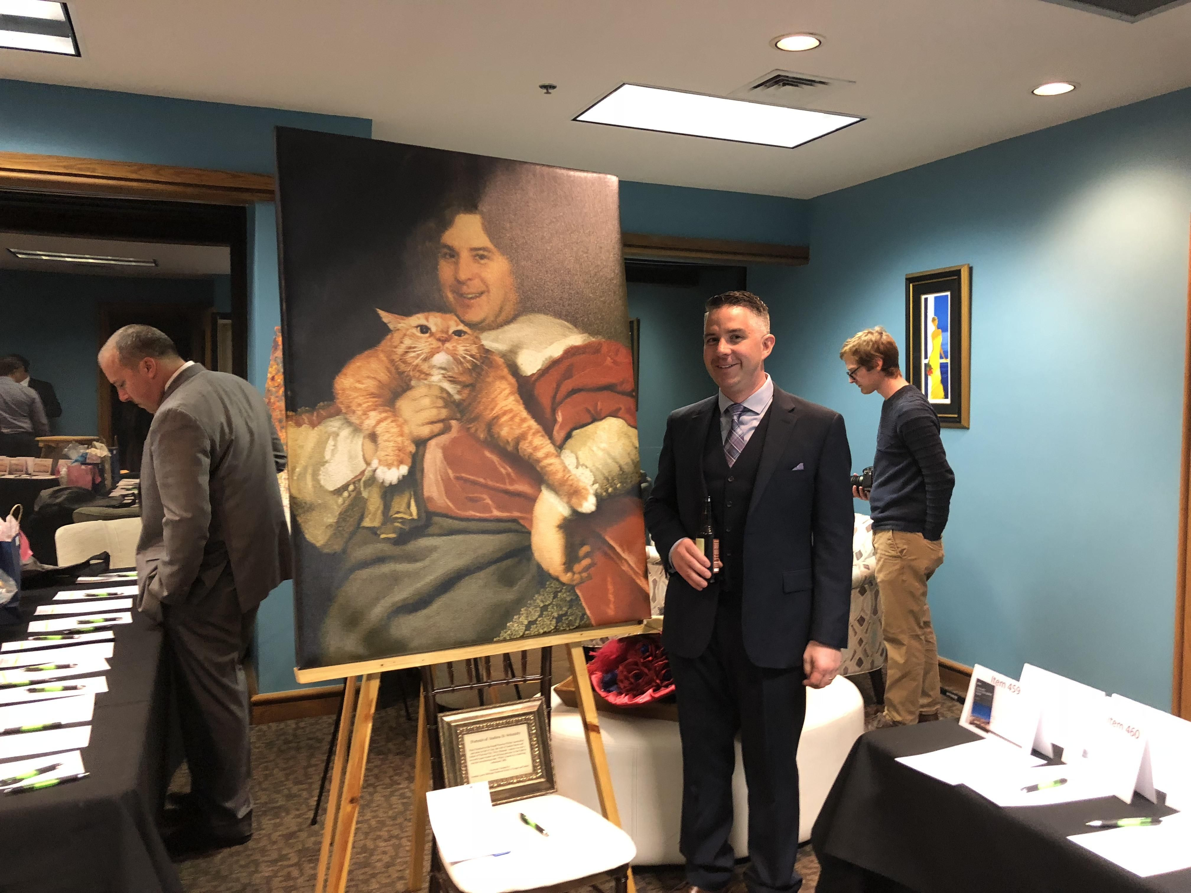 How to win a prank war. My friend snuck a heinous portrait of me into a charity auction that I was attending. Sold for $200.