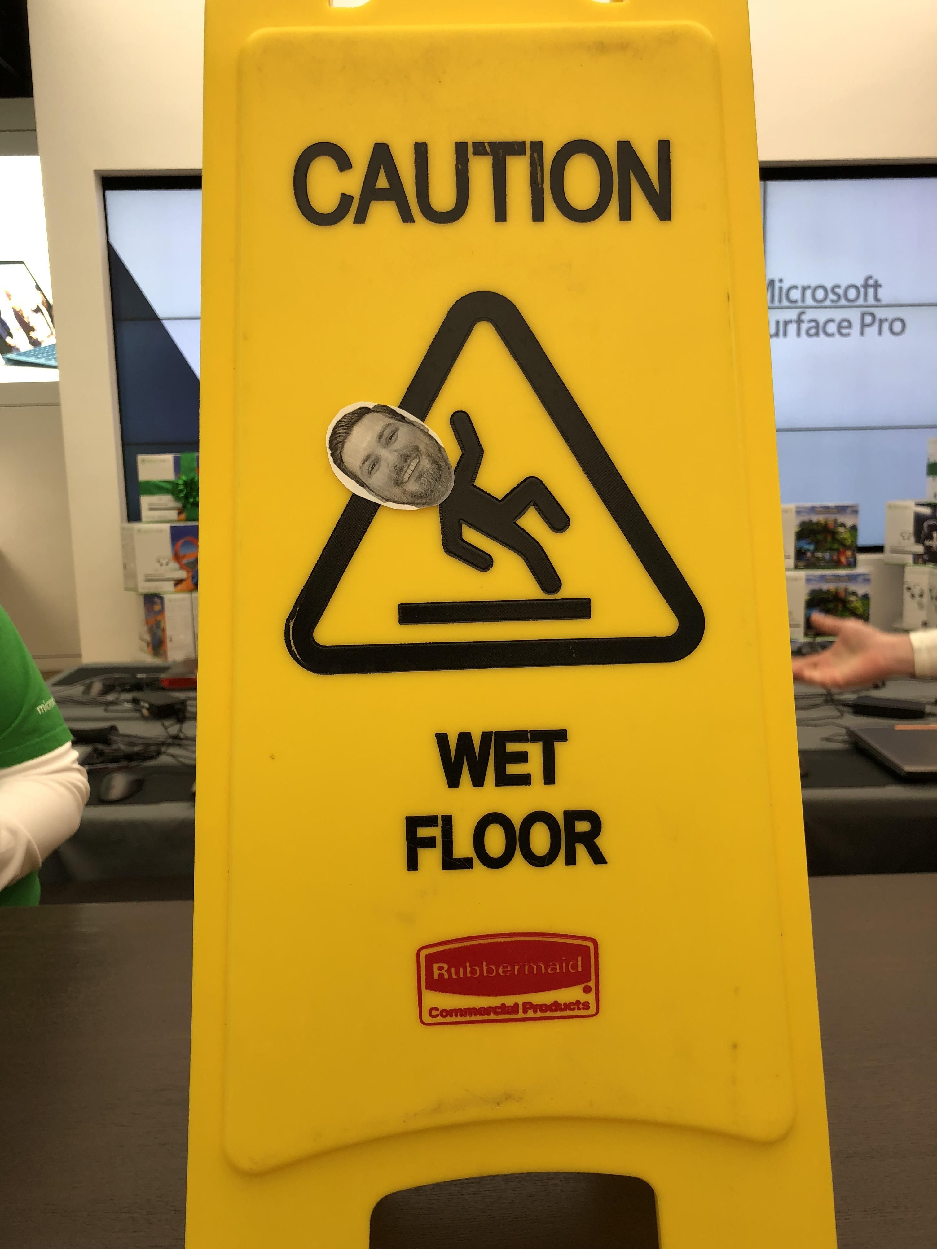 A coworker of mine slipped at work. Someone decided to post his face on the wet floor sign.