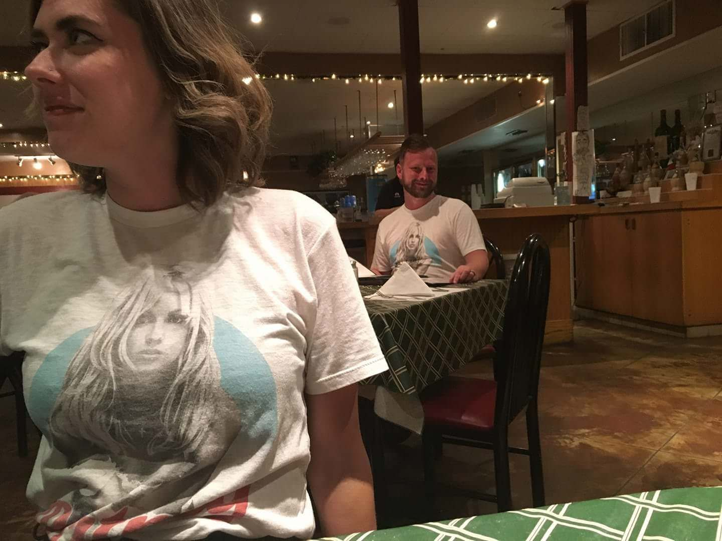 My friend is on vacation, and while out at a restaurant, a guy points out he's wearing the same shirt as his girlfriend.