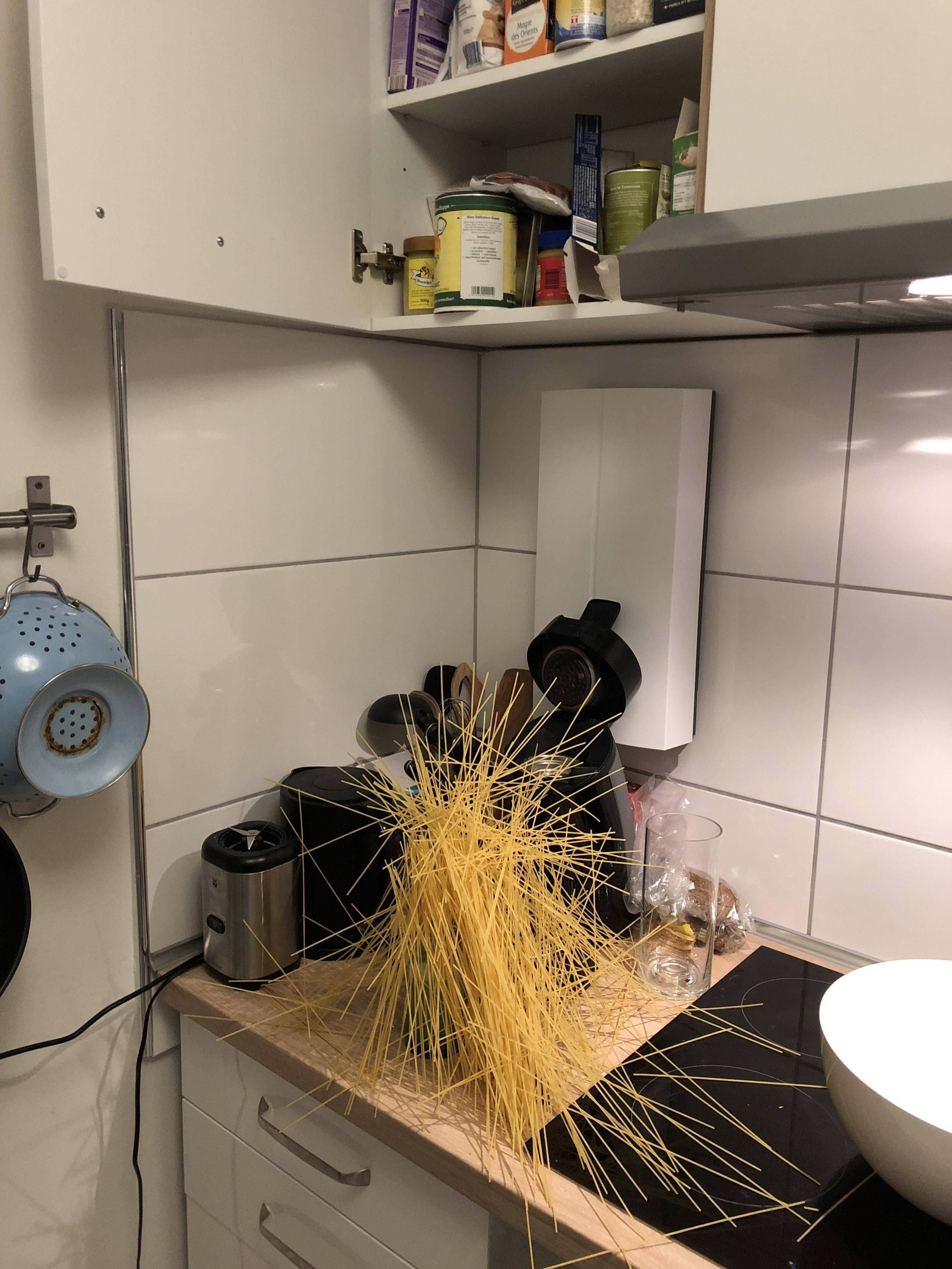 Opened the cupboard and the spaghetti just fell out like that. I think I created a piece of art.