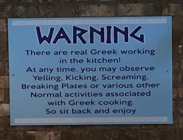 This sign is hanging in the dining area of our local Greek restaurant.