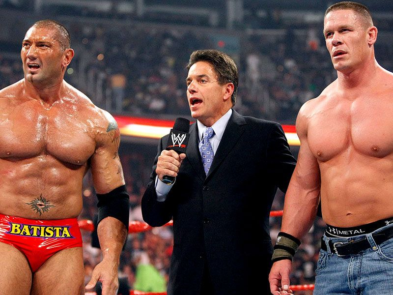 I can see Cena, but I feel as though there's another dude that is standing so incredibly still...