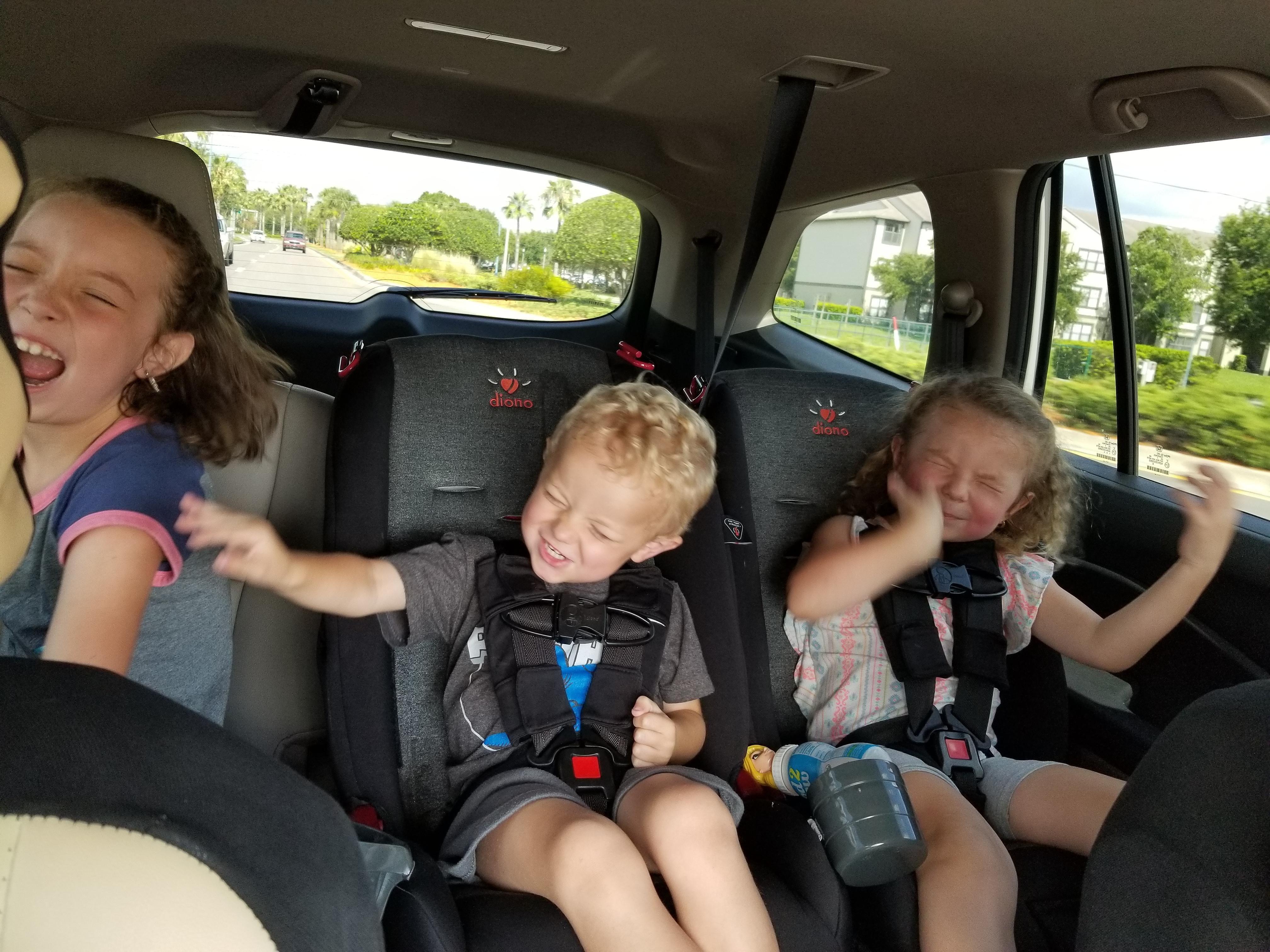 Kids first time hearing Bohemian Rhapsody... air guitars abound