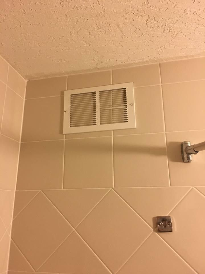 The vent in my hotel bathroom doesn't seem to be working.