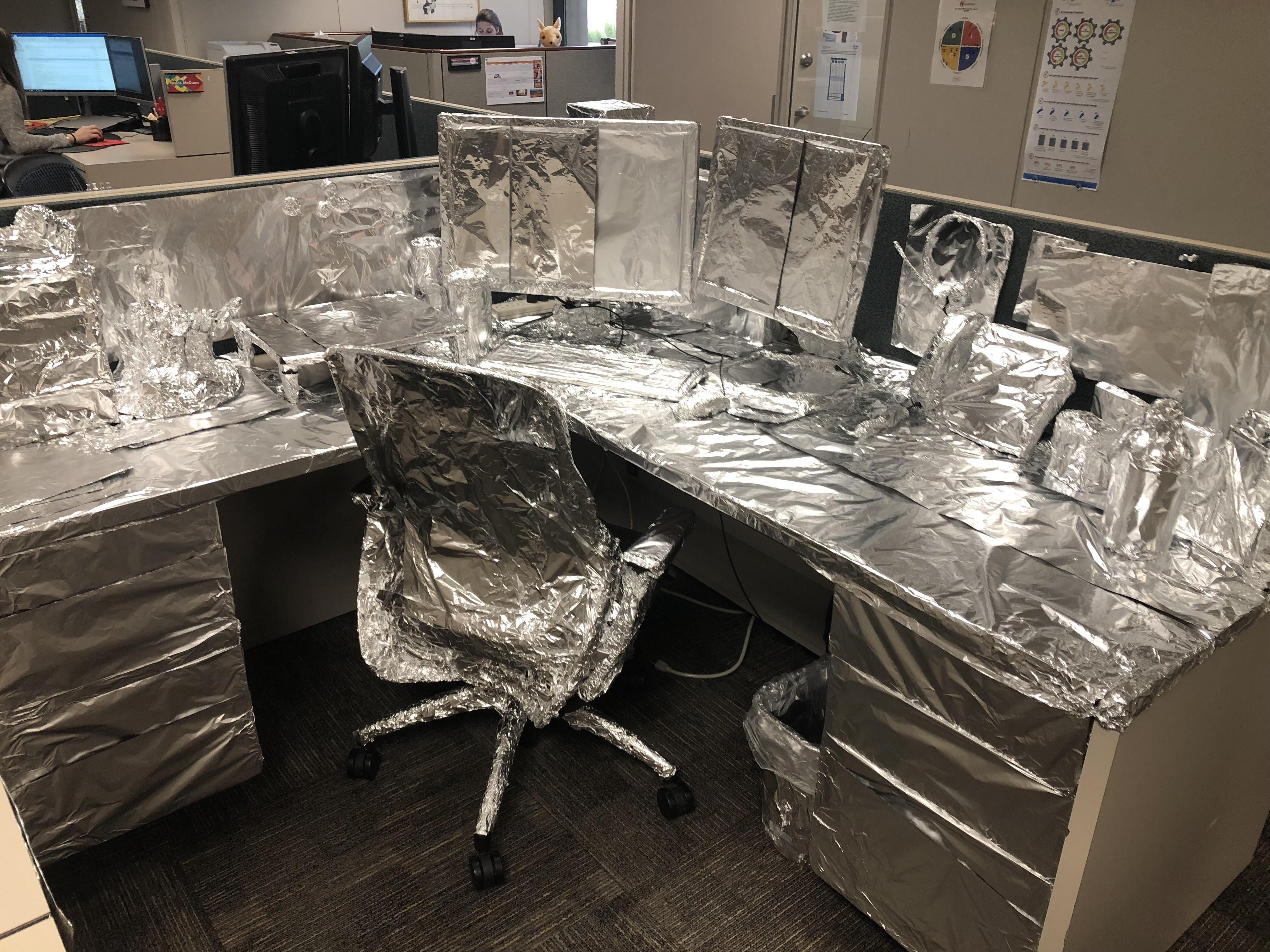 Came back from a long vacation to literally every single thing on my desk wrapped in tin foil