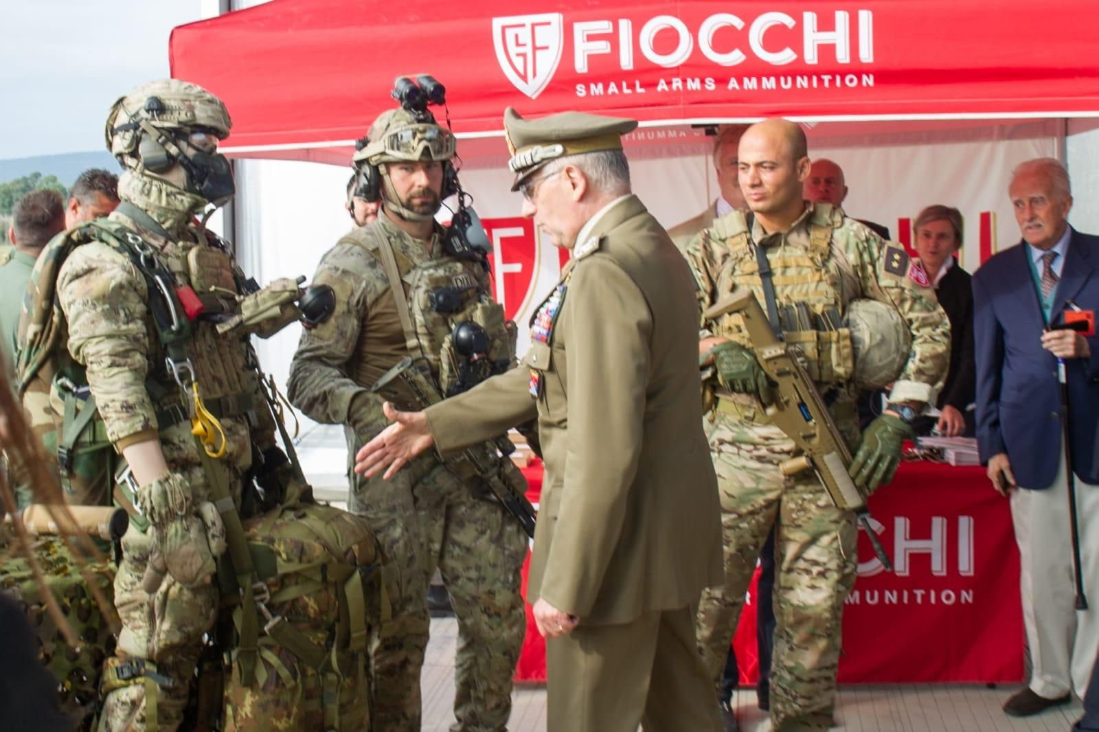 Italian Army General Claudio Graziano trying to shake hands with a military dummy during an official event, 2018