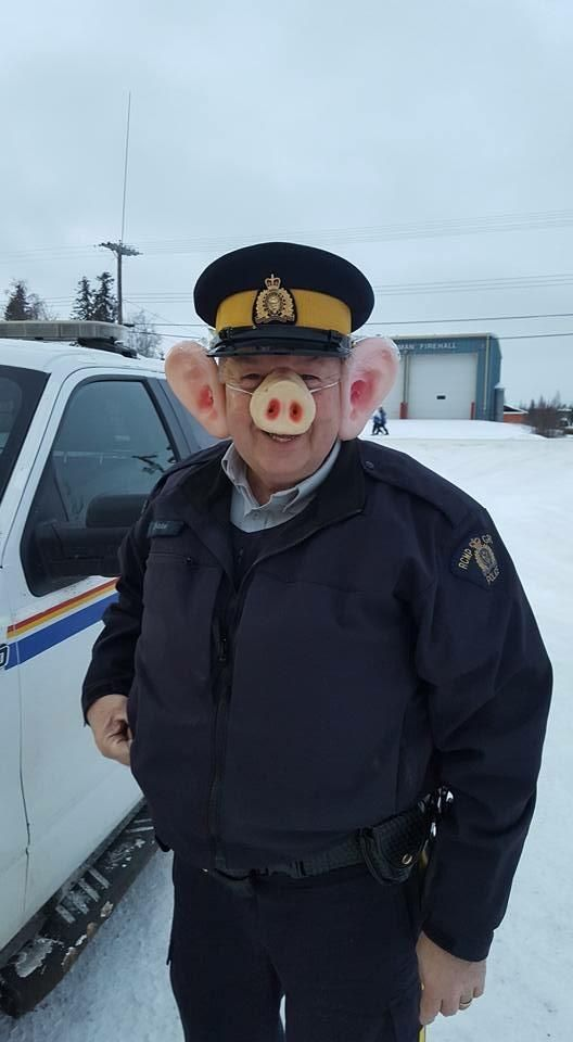This cop dressed up as a pig for Halloween.