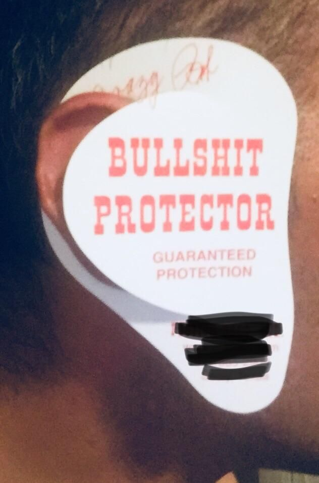 My client put this on his ear while I was going in for the close. I laughed quite hard. This is also his business card for his feed company.