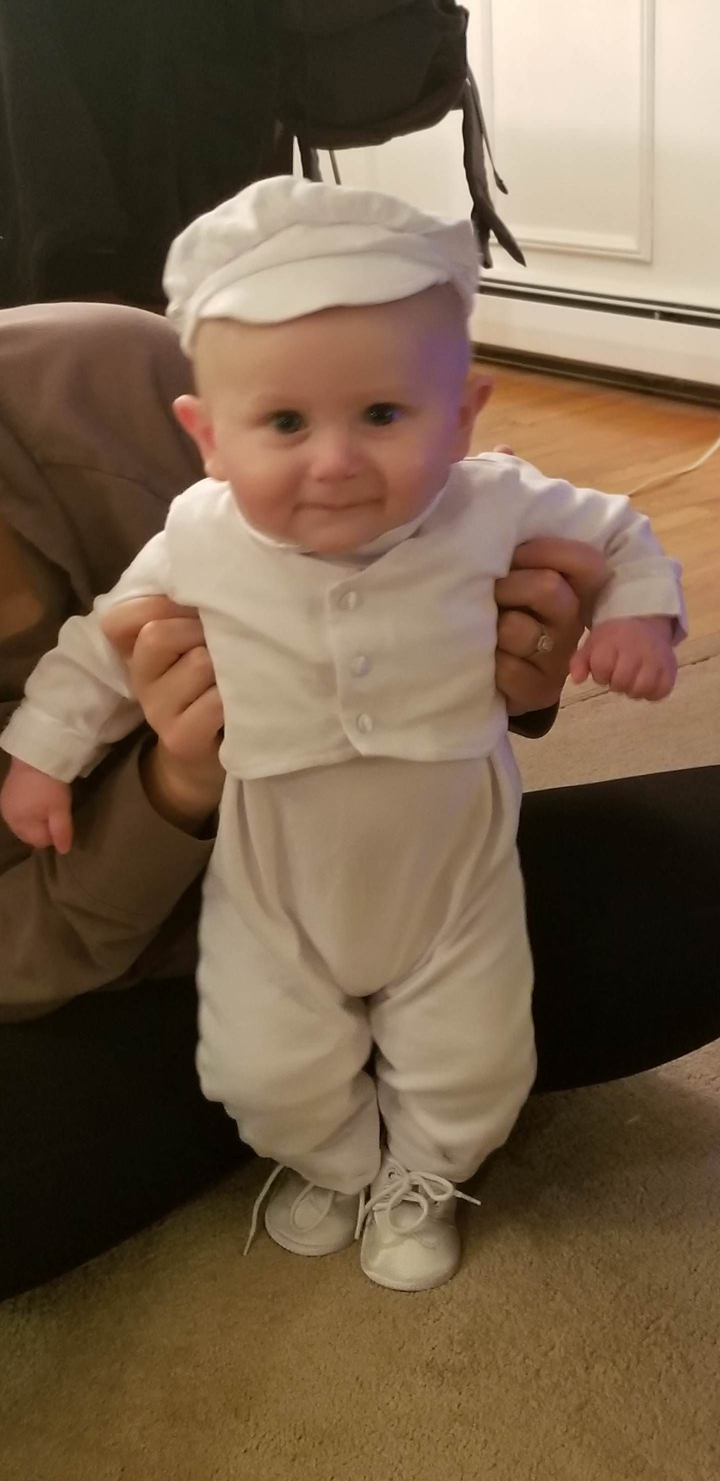 My sons christening tomorrow and the outfit my wife got him makes him look like a 1950's milk delivery man....