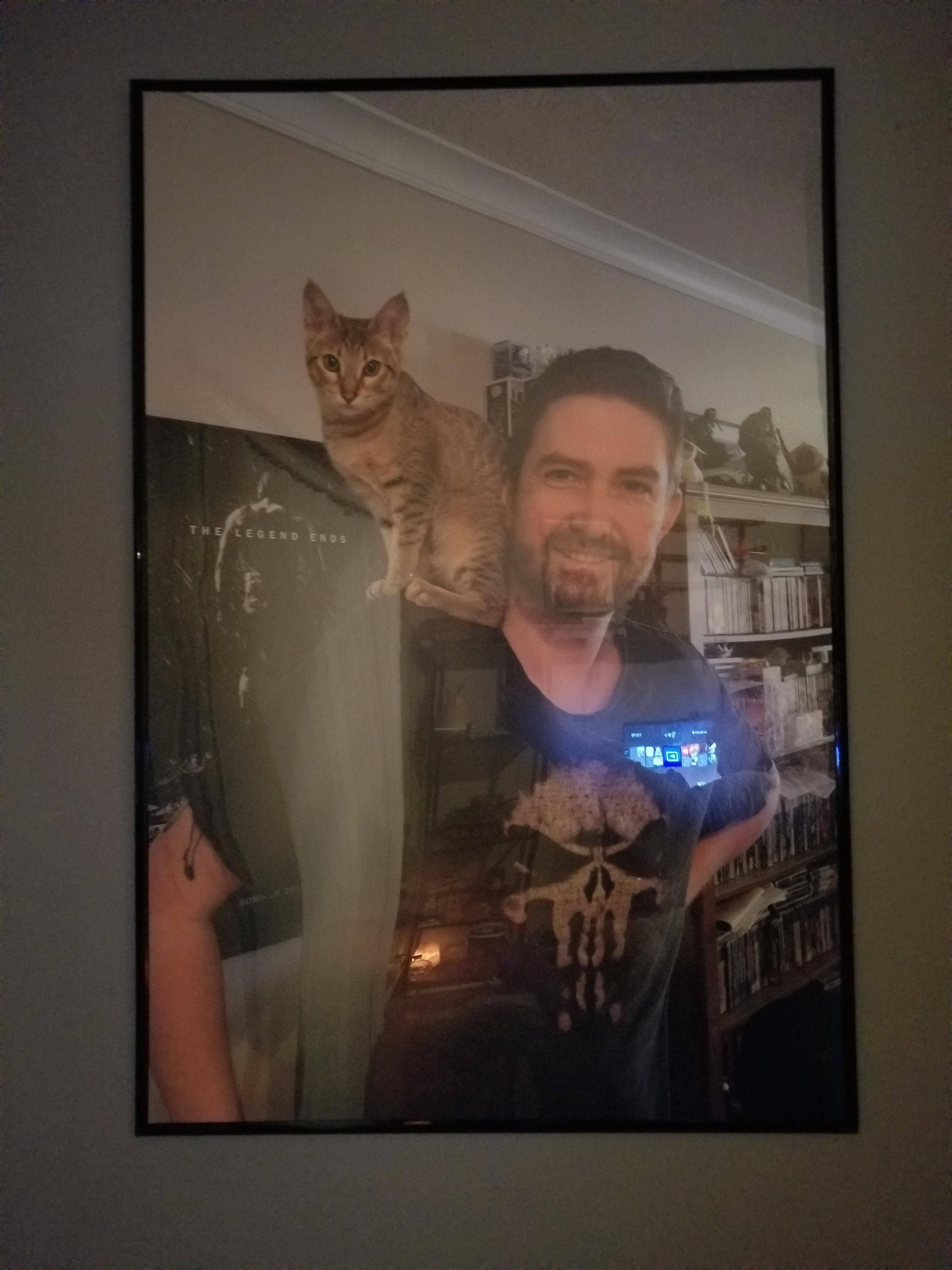 My buddy gave my fiance and I a photo of himself and his cat as a house warming gift.