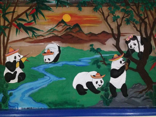 Mexican restaurant used to be a Chinese restaurant. Instead of removing this art, they just put sombreros on the pandas.