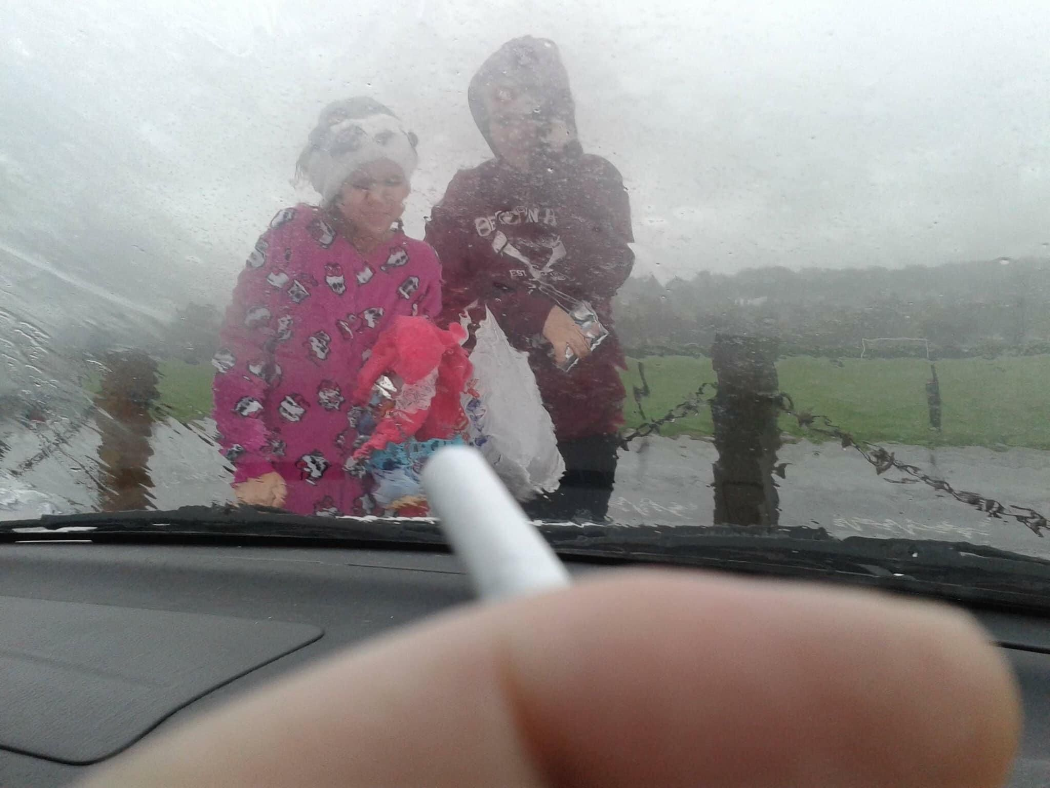 No smoking with kids in the car law is ridiculous. Just look at them out there in the rain.
