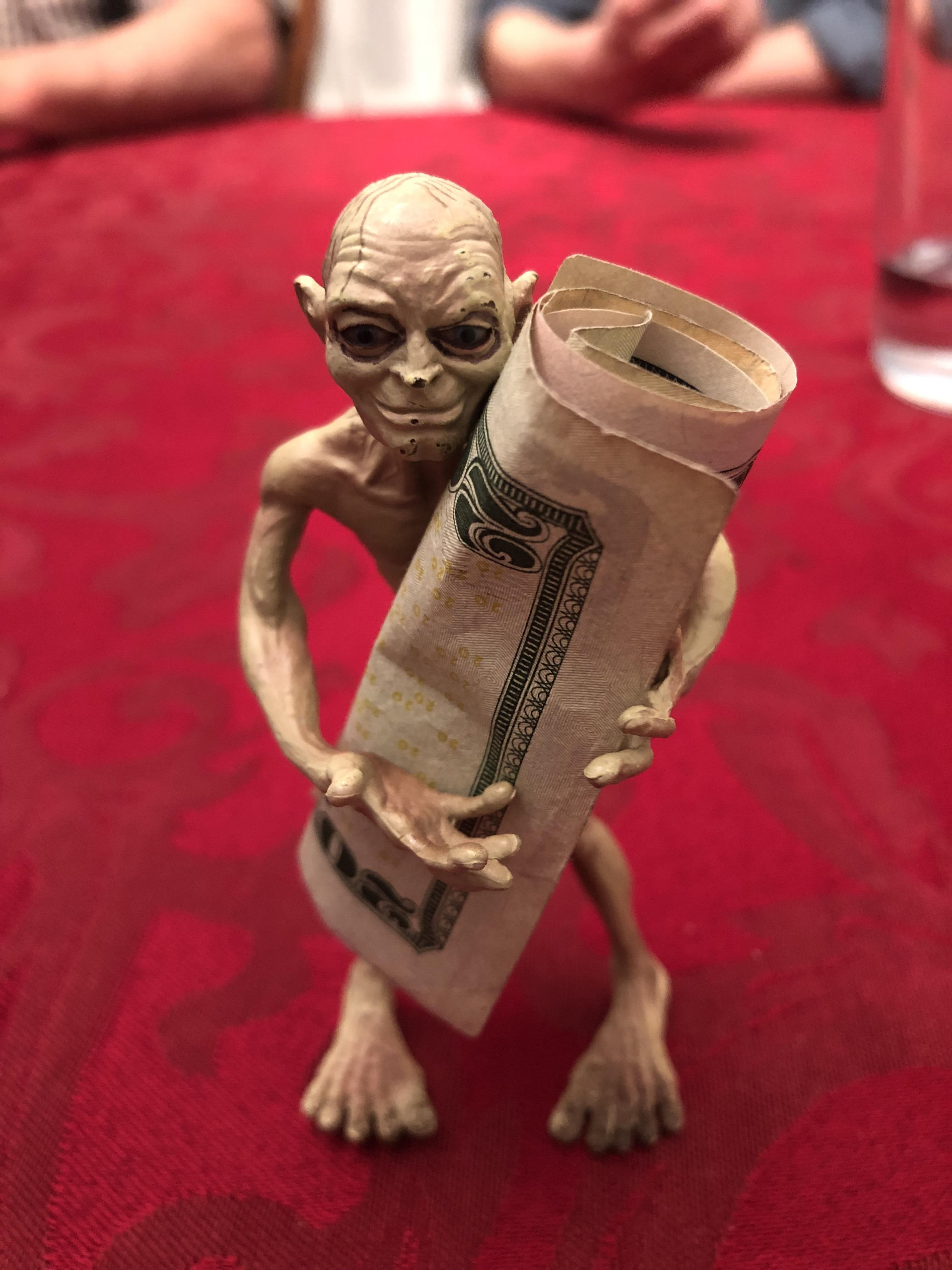 My family and I use this Gollum toy to hold the money when we play cards.