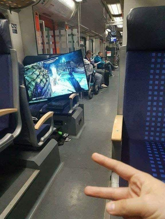 Someone playing a game in a train