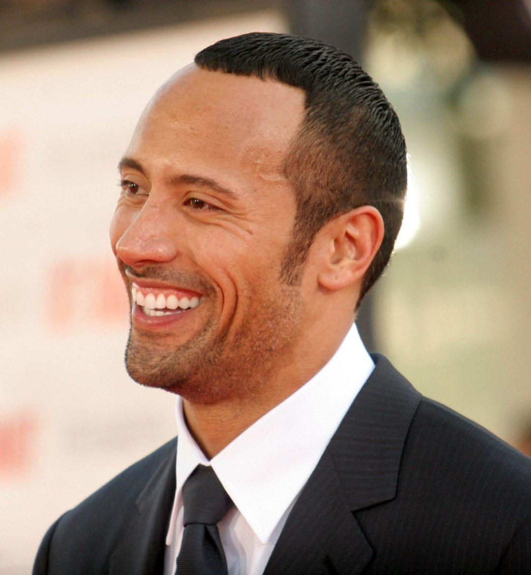 The rock used to look like he had stolen his hair from a man with a much smaller head.