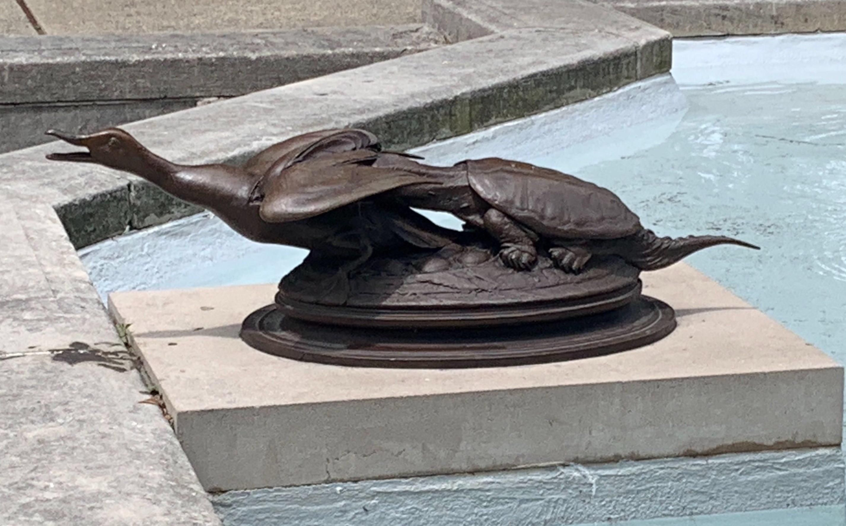 There's a statue by my friend's office that looks like a turtle eating out a duck's ass