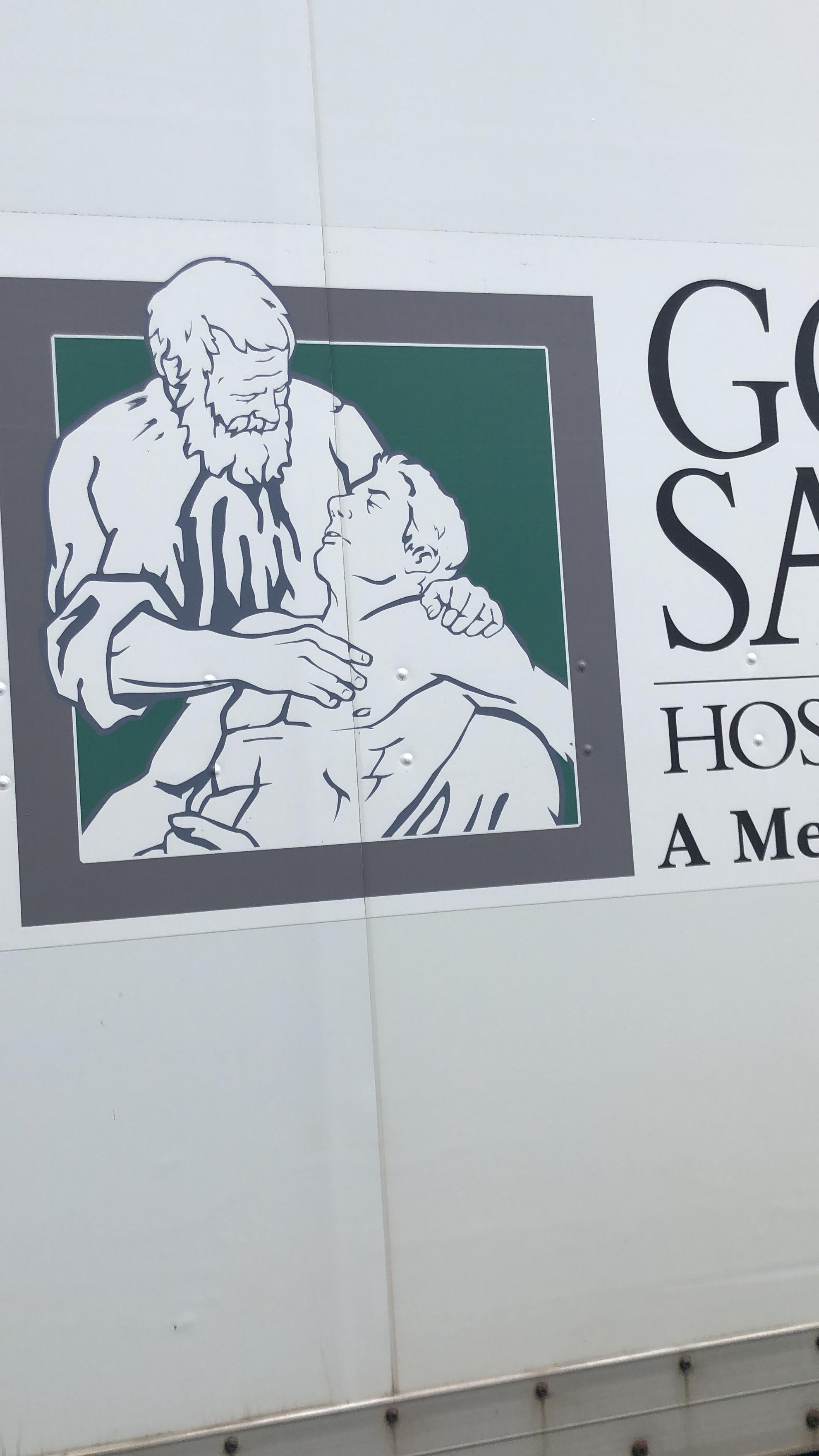 Good Samaritan Hospital's logo looks like David Letterman giving a massage to a buff Martin Short.