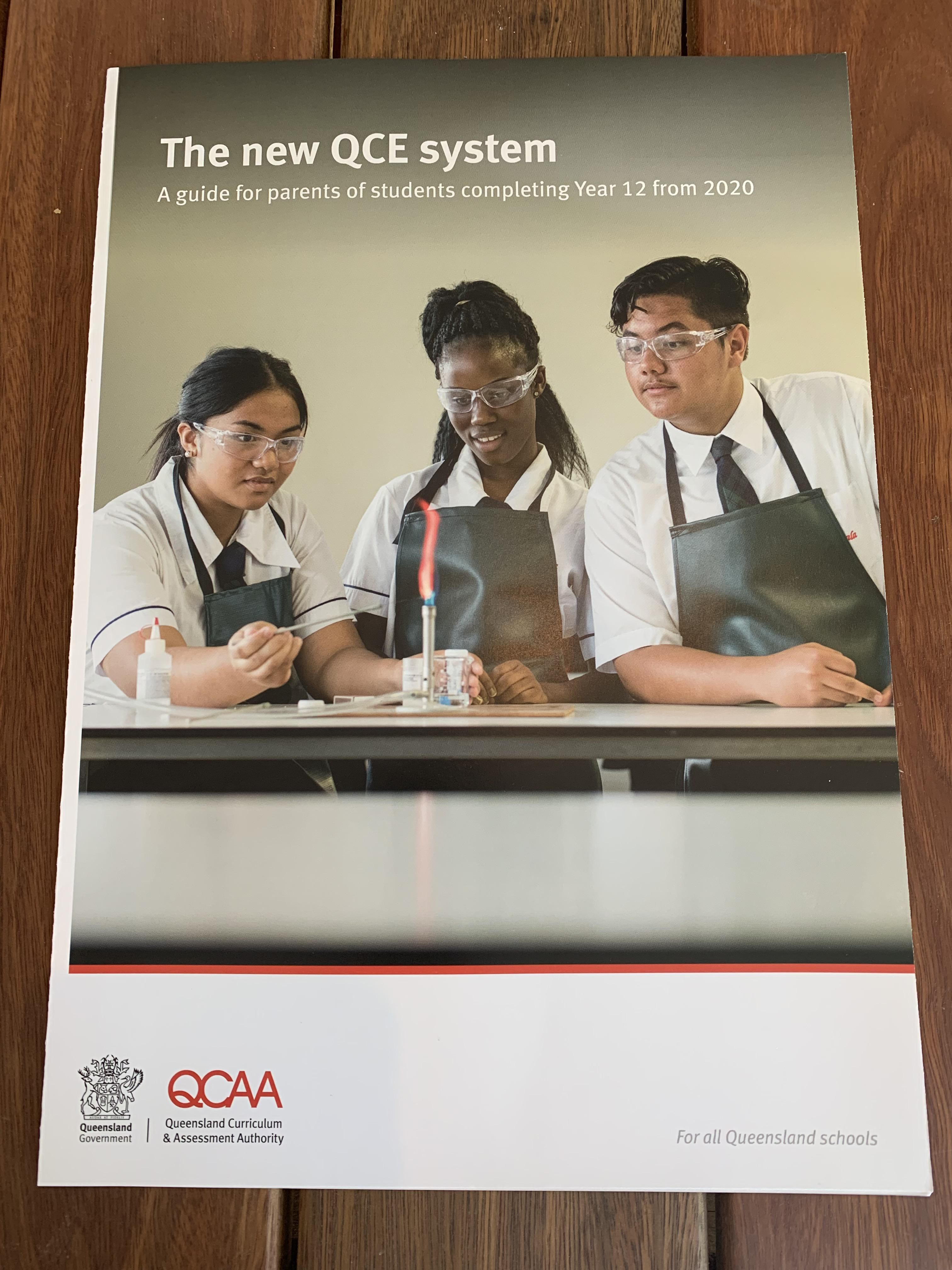 The kid on the right successfully trolled the State Education Department on the cover of a publication that has now been sent out to a million families