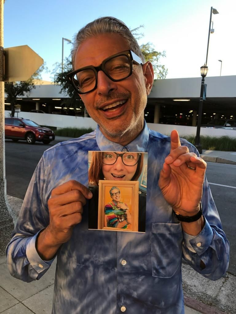 Jeff Goldblum found out that my friend keeps a framed photo of him on her desk. They both seem very pleased.