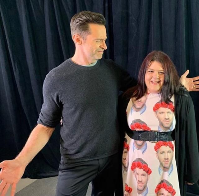 Fan wears a Ryan Reynolds shirt to meet Hugh Jackman.