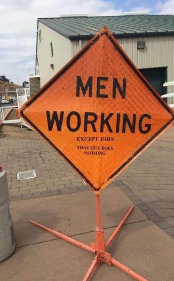 Construction sign calling out John.