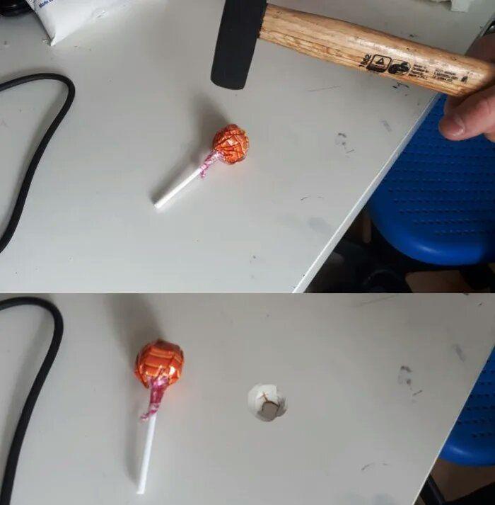 Using a hammer on a lollipop