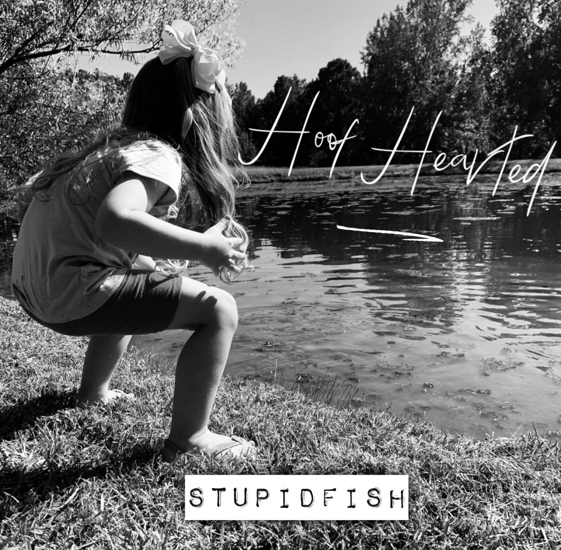 Tried to take a cutesy picture of my daughter sitting by the pond. She stood up halfway through and I thought it looked like she was screaming angrily at the fish. Made it into a fake album cover.