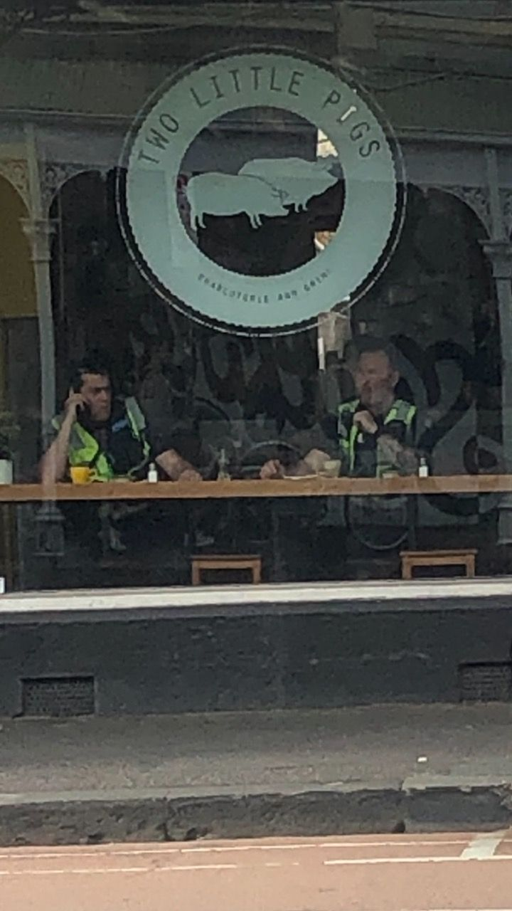 Cafe across from me is called 2 little pigs. There just happened to be 2 police officers sitting under the sign.
