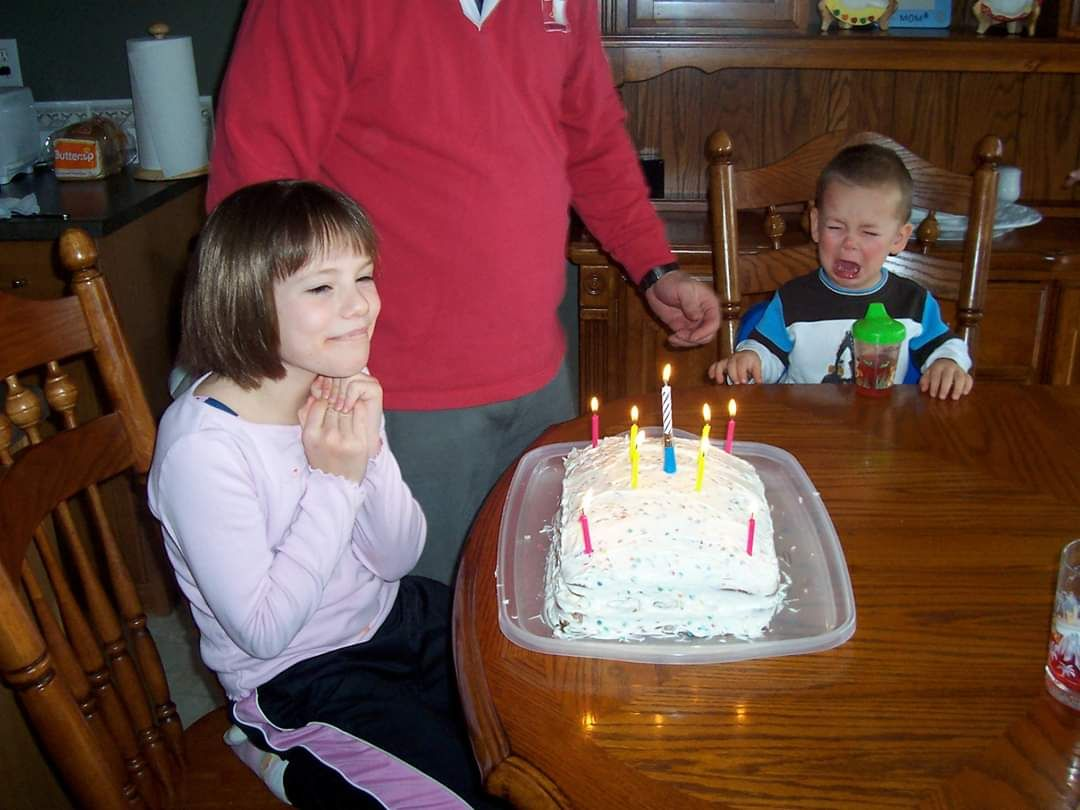 My brother crying because he cant blow out the candles. And me, not giving a ***.