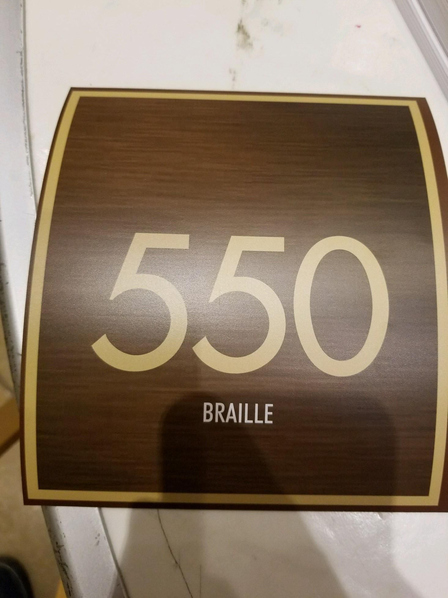 My friend works for a contracting company that is renovating a hotel. They asked for room numbers, with braille on the bottom for blind people to read. This is what their supplier sent them .