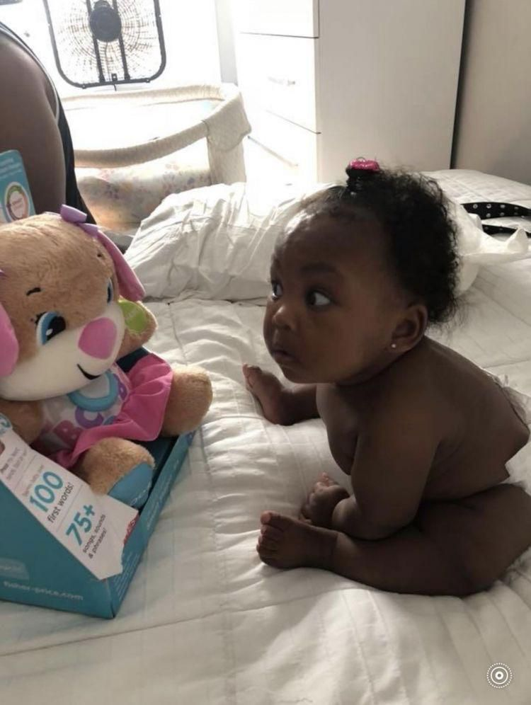 This little girl is skeptical AF & who can blame her? The bear is her size, talks, and makes strange eye contact at all times