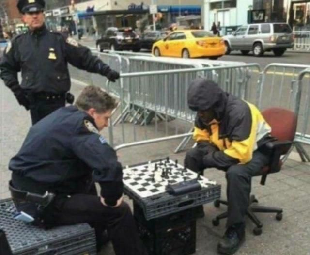 A cop beats a unarmed black man while another watches