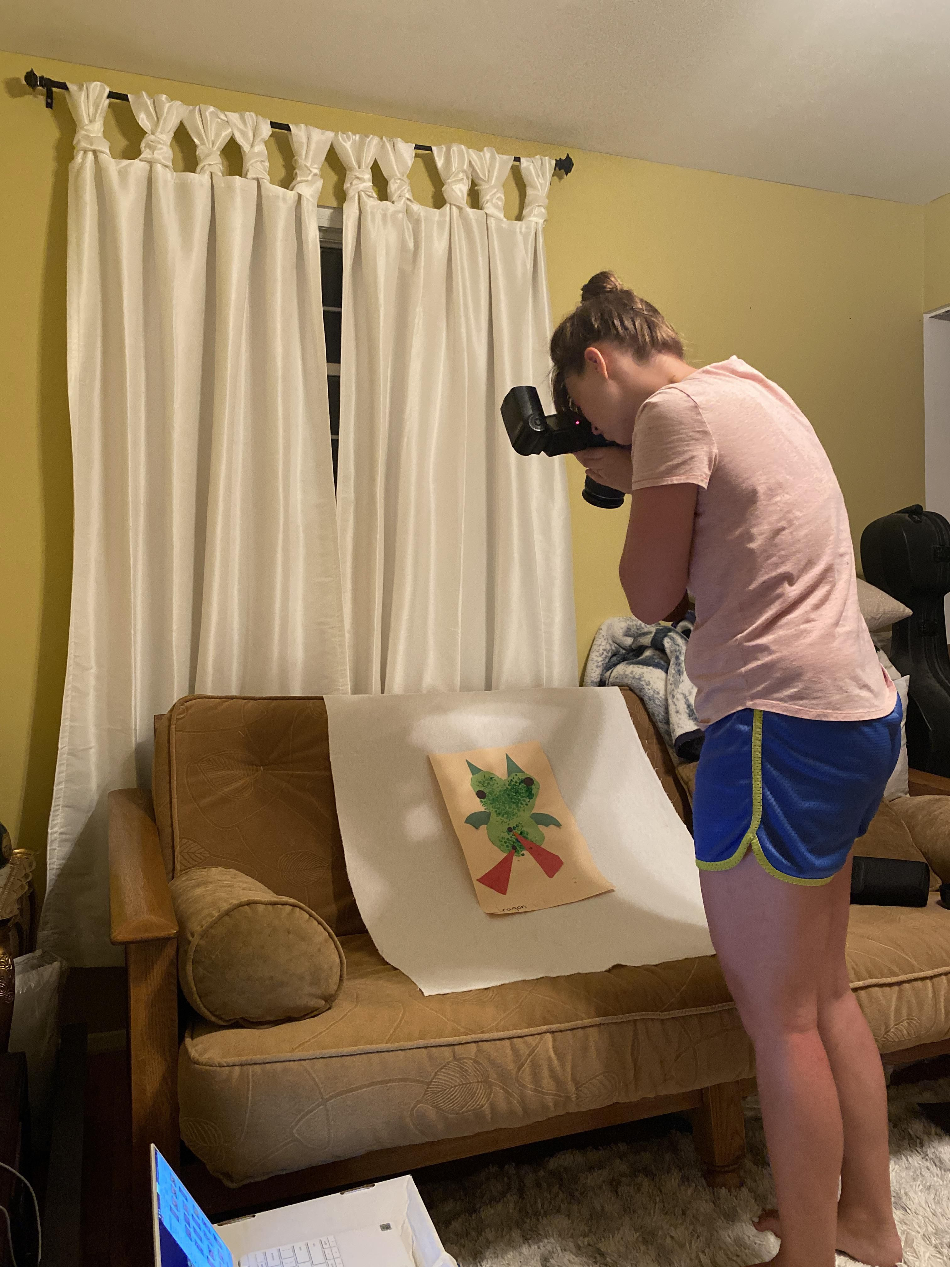 """I just sat in the backyard for ten minutes watching """"heat lightning"""" then came inside to find my wife photographing our son's preschool artwork with the big flash. Friggin' idiot I am."""