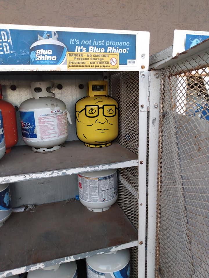 This propane tank painted like Hank Hill's Lego head