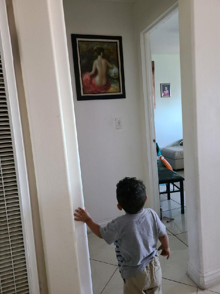 Every time we go to Grandma's house he goes straight to this picture and stares endlessly.