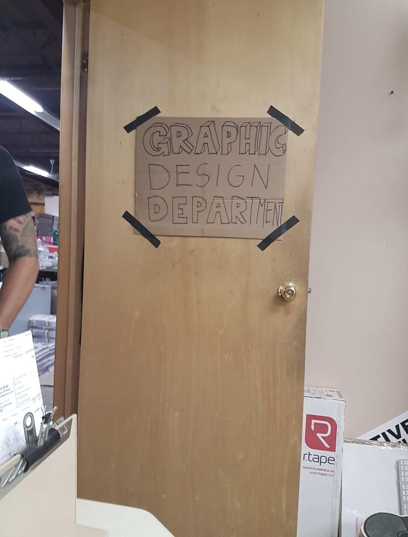 The sign on my husbands graphic design department
