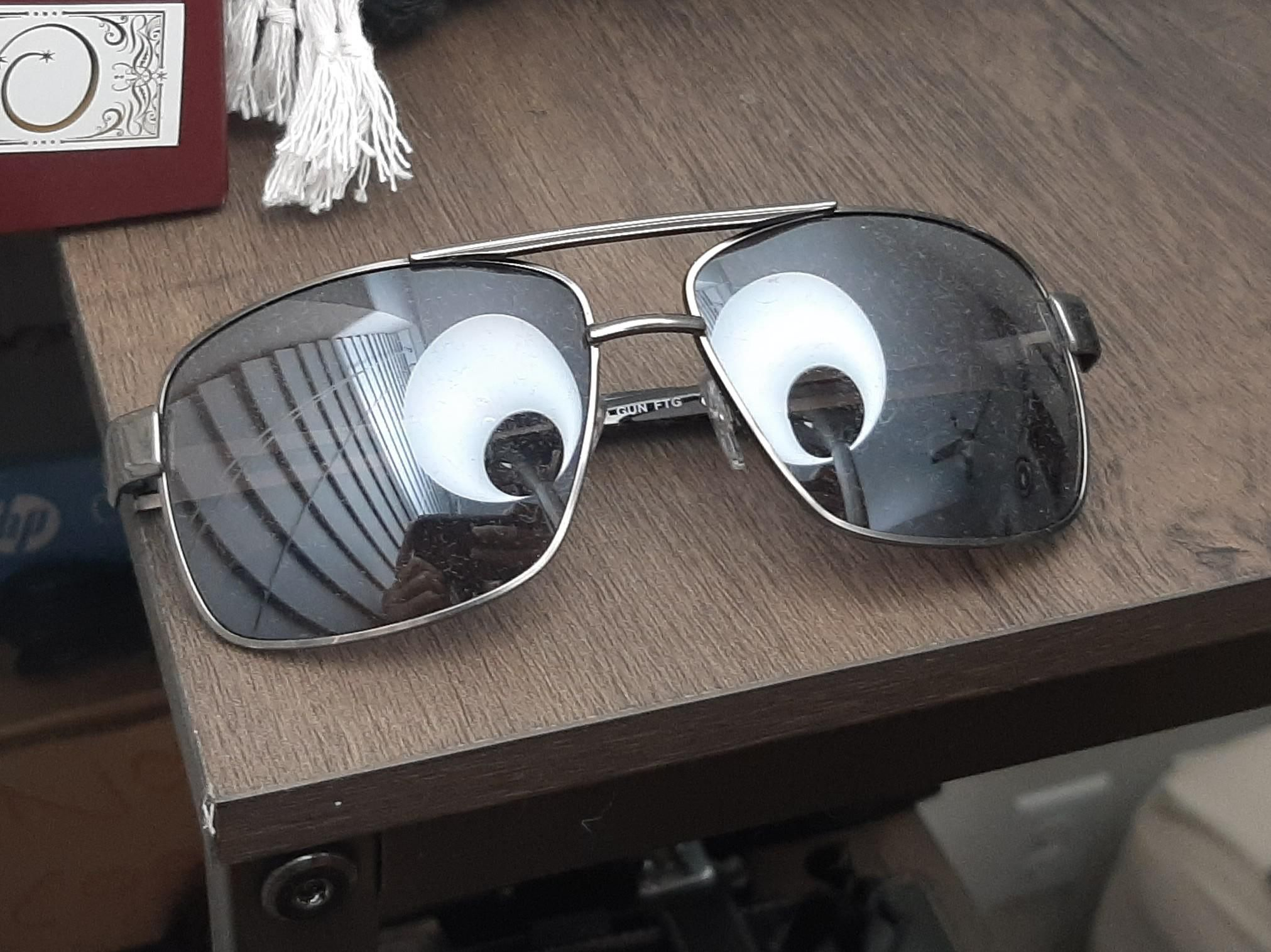 The lamp looks like googly eyes on my shades!
