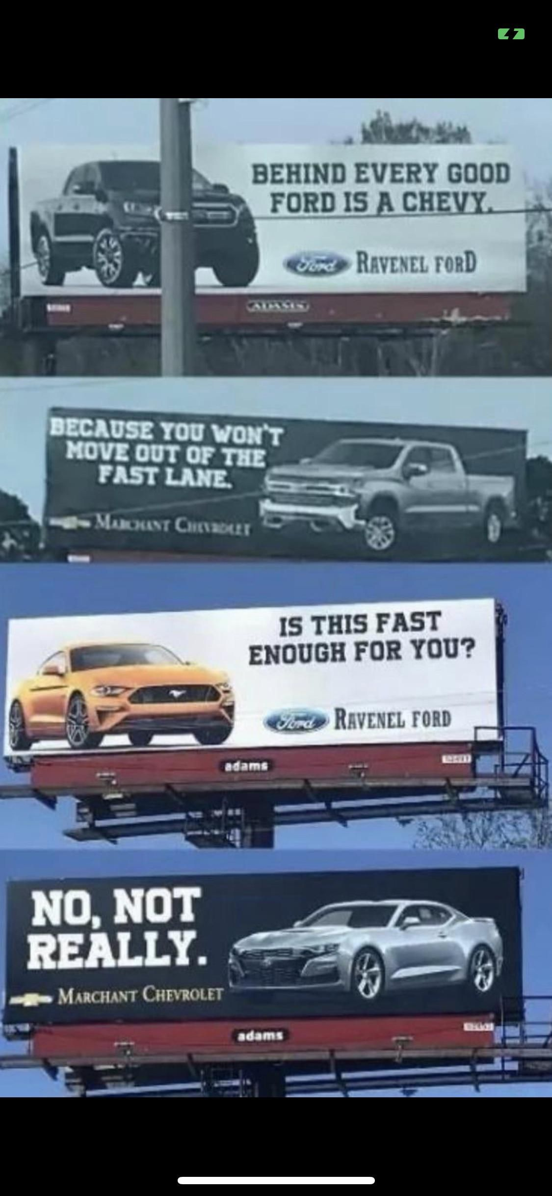 Some serious competition between two car dealerships.