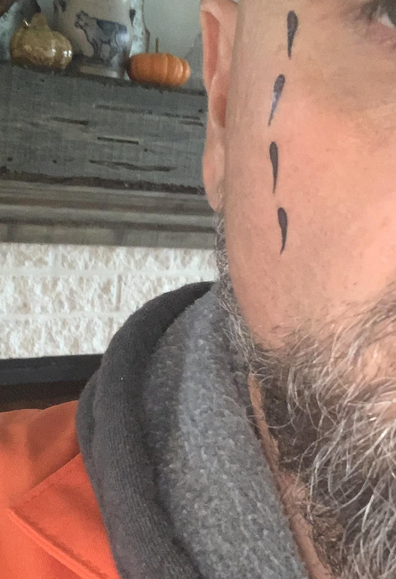 Dressing up as a convict to pass out candy. Wife put fake tear tattoos on upside down. Now I have sperm tattoos on my face.