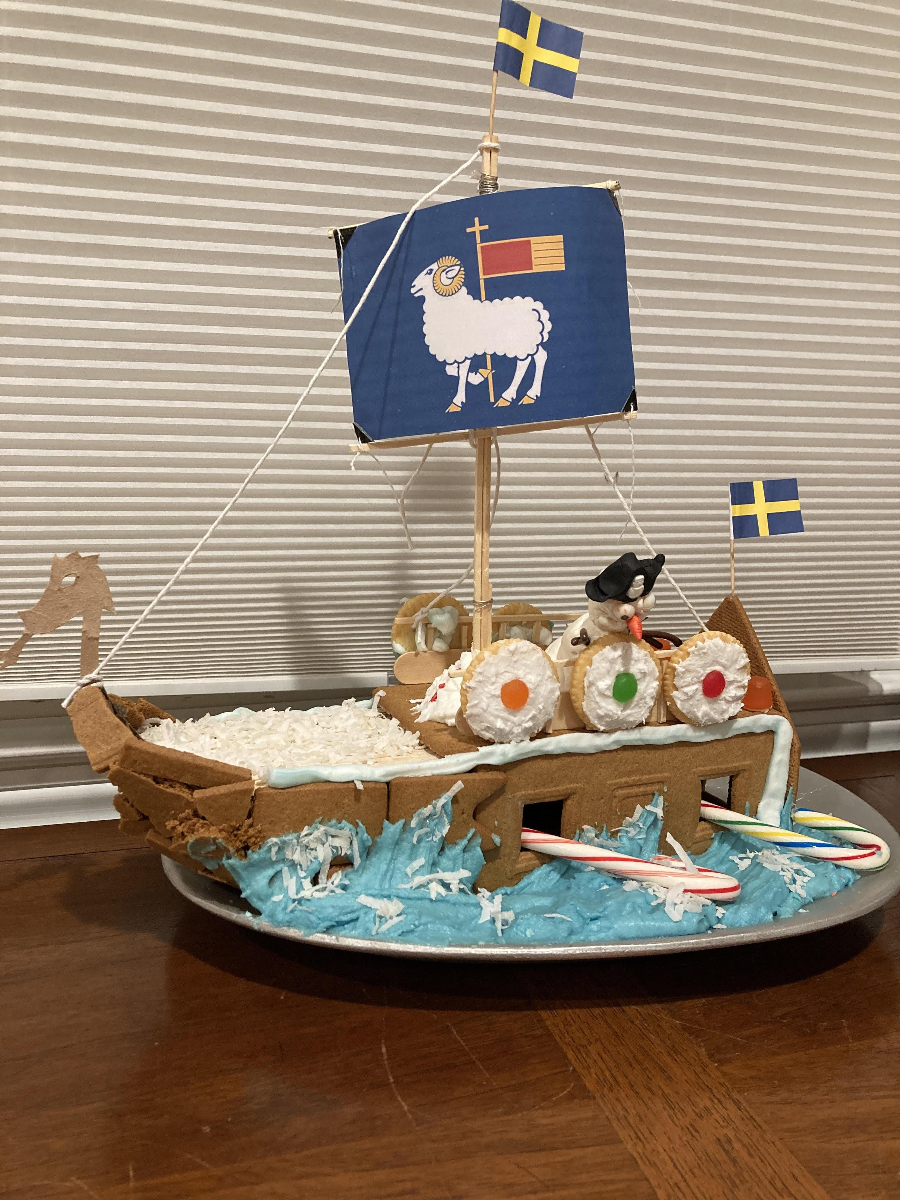My son and his friend designed our submission for the extended family gingerbread house contest