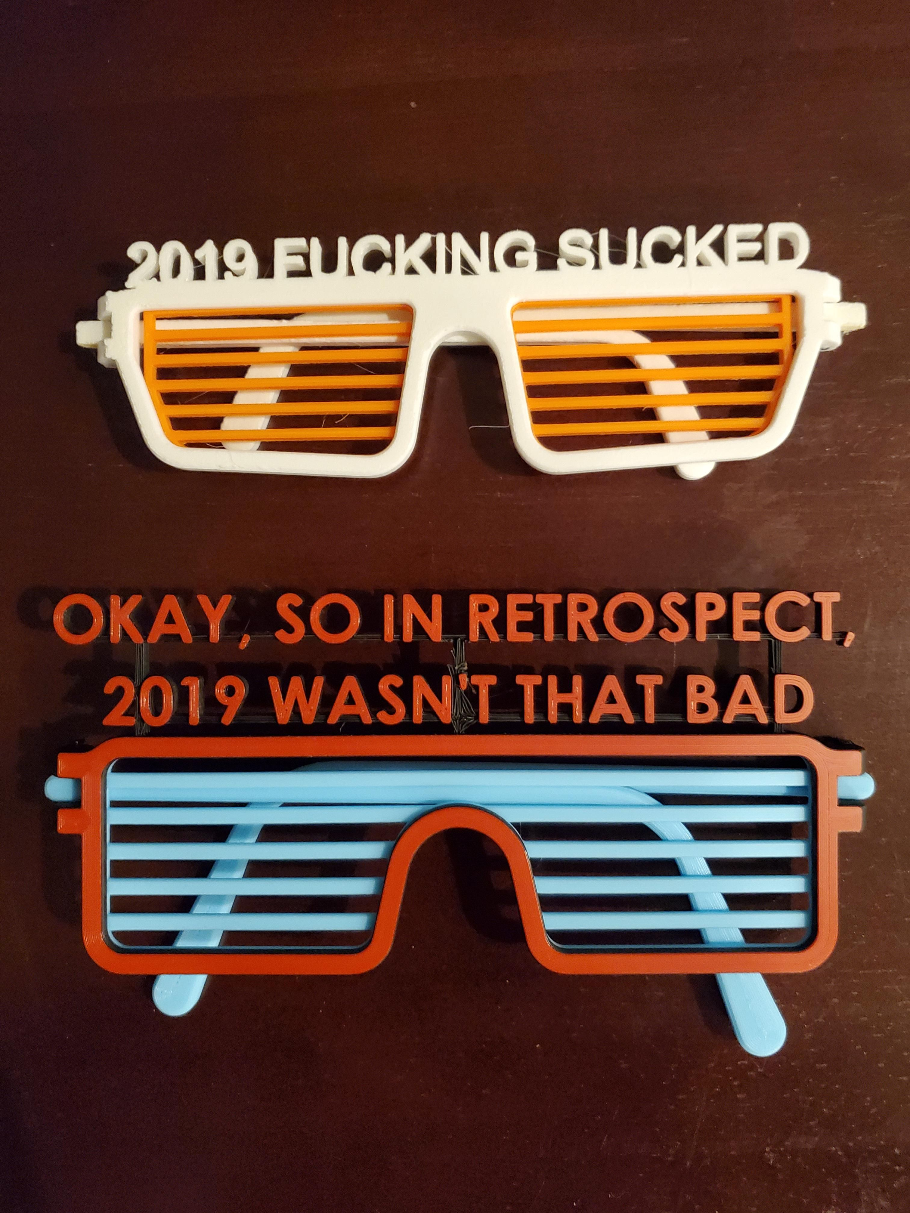Behold! My friend makes glasses each year for his New Year's get together. 2019 edition vs 2020 edition .