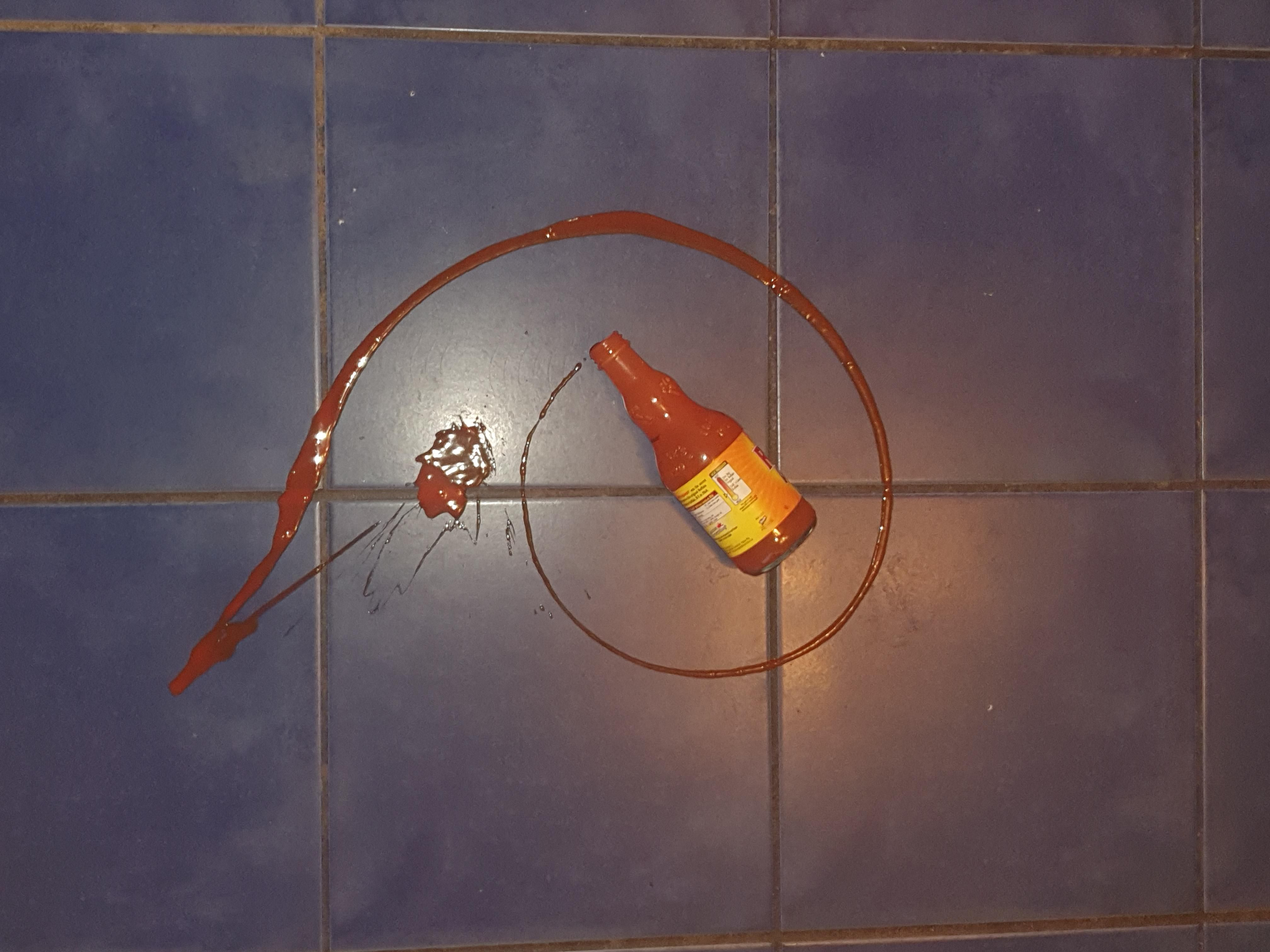 Dropped my bottle of Frank's hot sauce from the fridge and the spillage looks like the golden ratio. The universe is trying to tell me something.