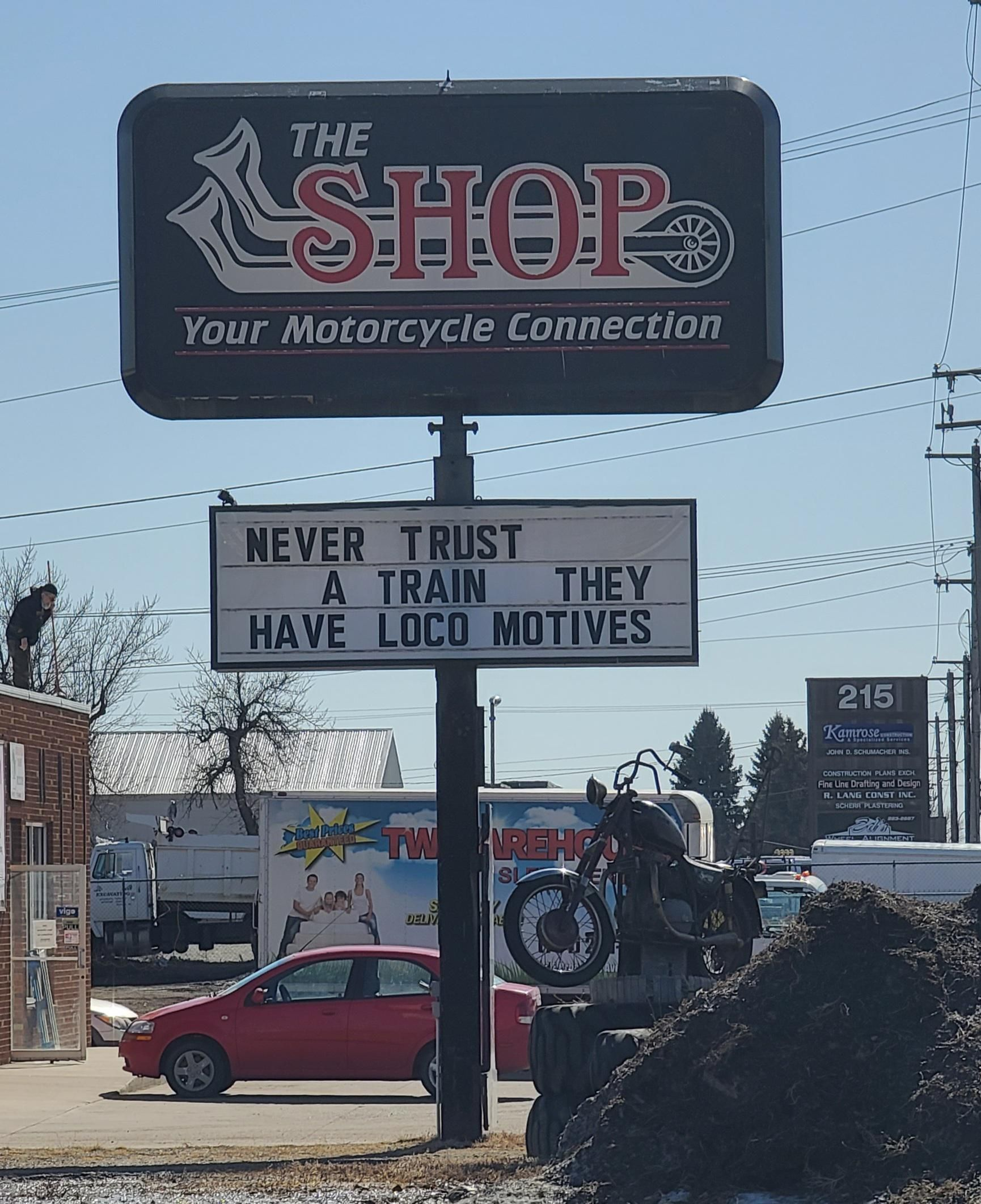 Local Motorcycle Shop Sign