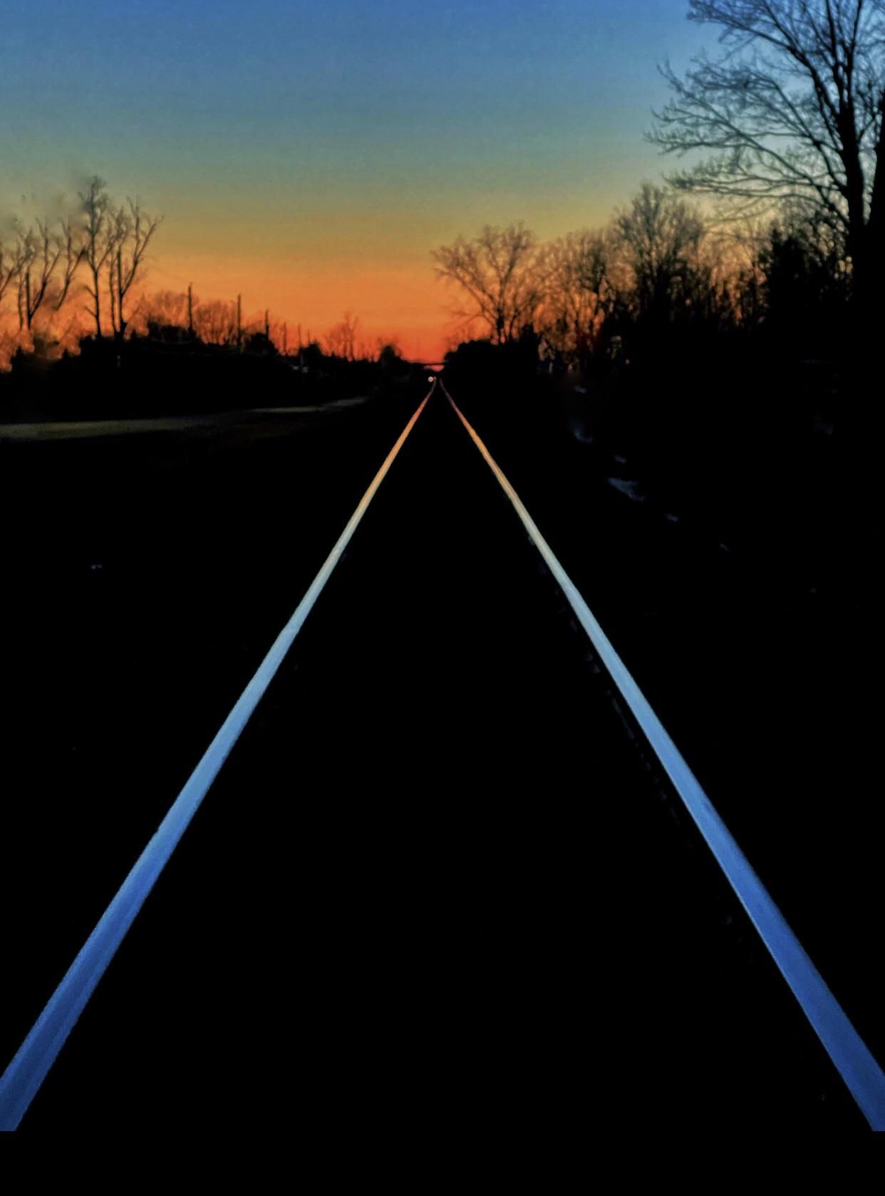 Train tracks at night