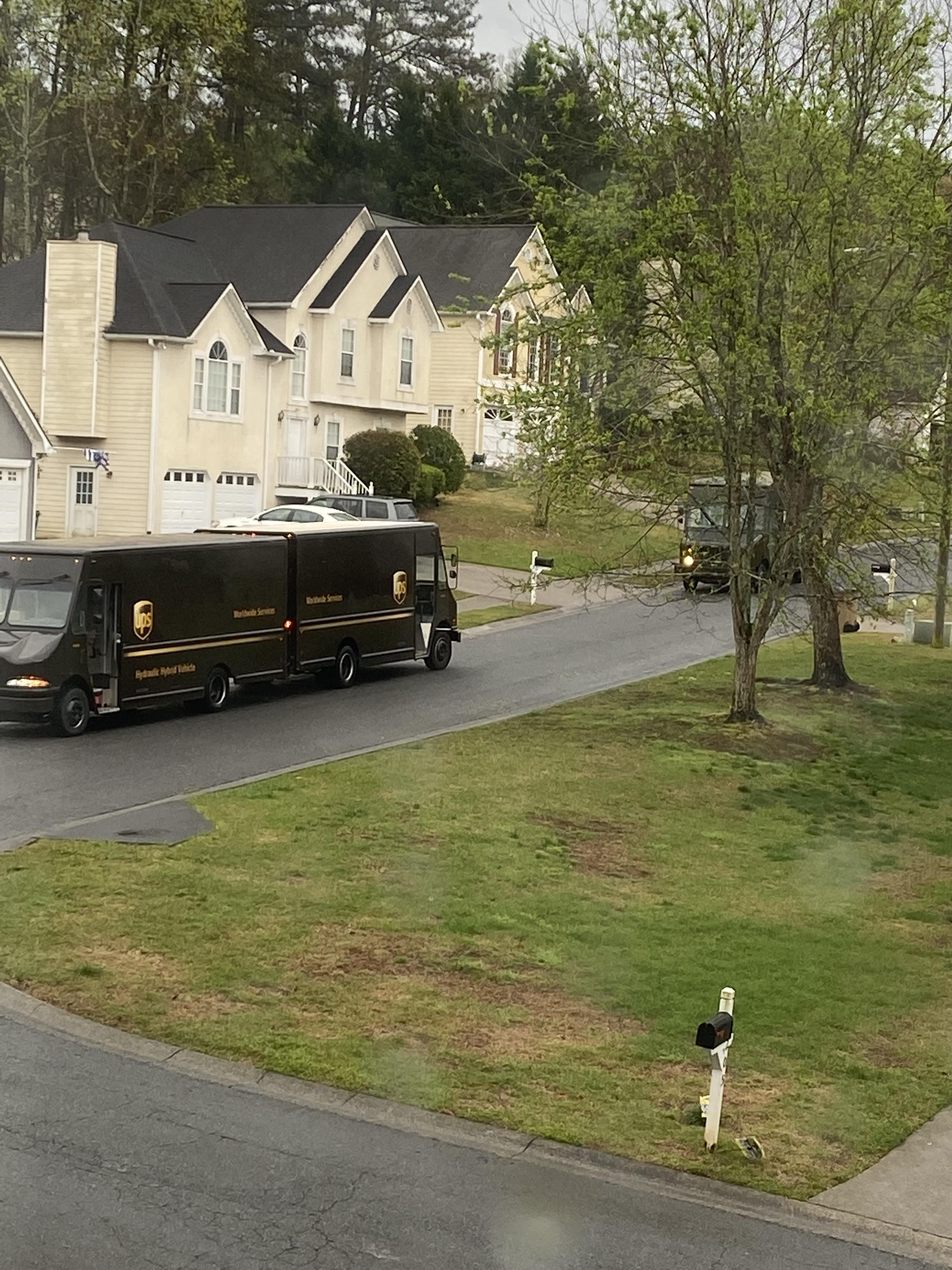 Spring is in the air! Behold the rarely photographed mating ritual of the big brown truck.