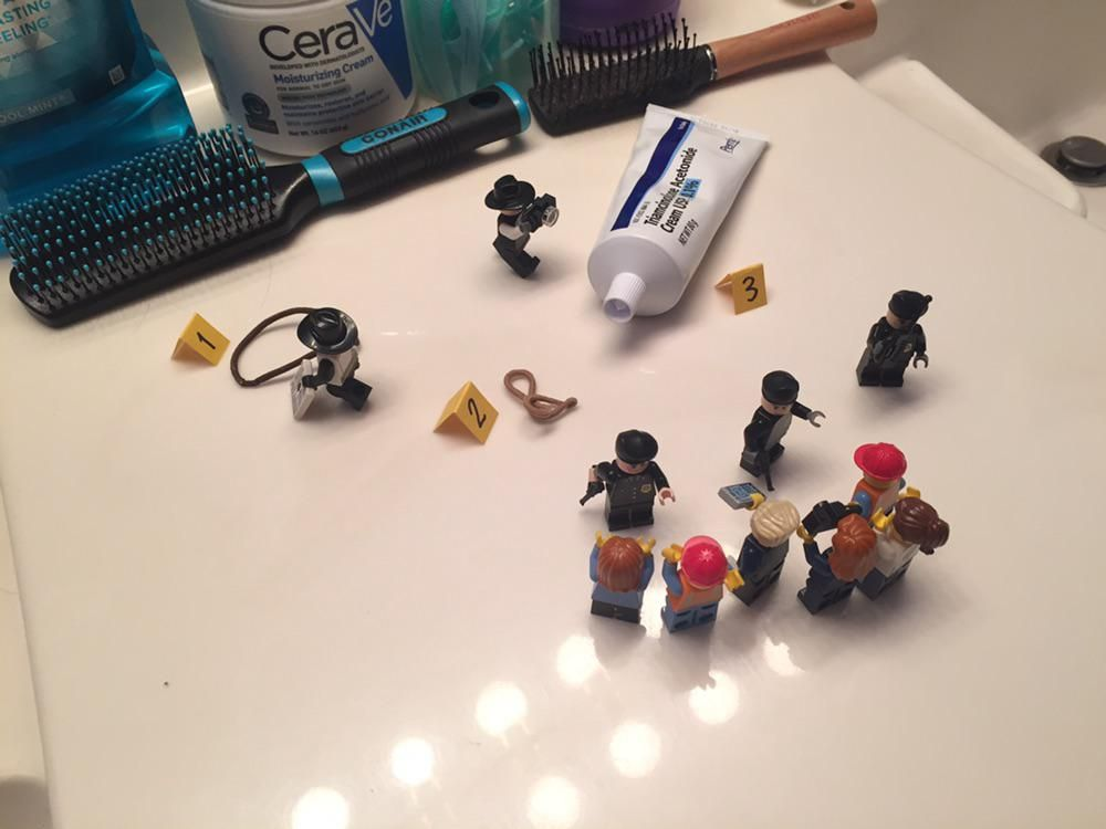 My brother cleaned and organized our bathroom while I was away last week. Last night I accidentally left some things out, so he set this little scene up with his Legos