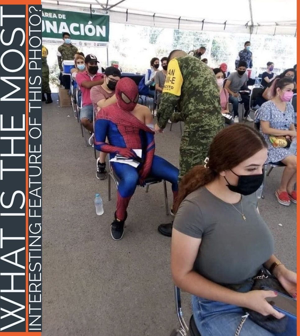 The dude who dressed up as spider man to get his shot! Duh.